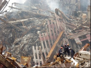 firefighters-on-debris-pile-copy