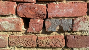 crumbling brick-wall