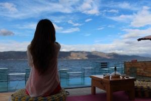 girl meditate near water