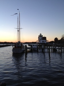 harbor sailboat and lighthouse