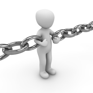 figure held by chain