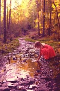 girl red dress creek